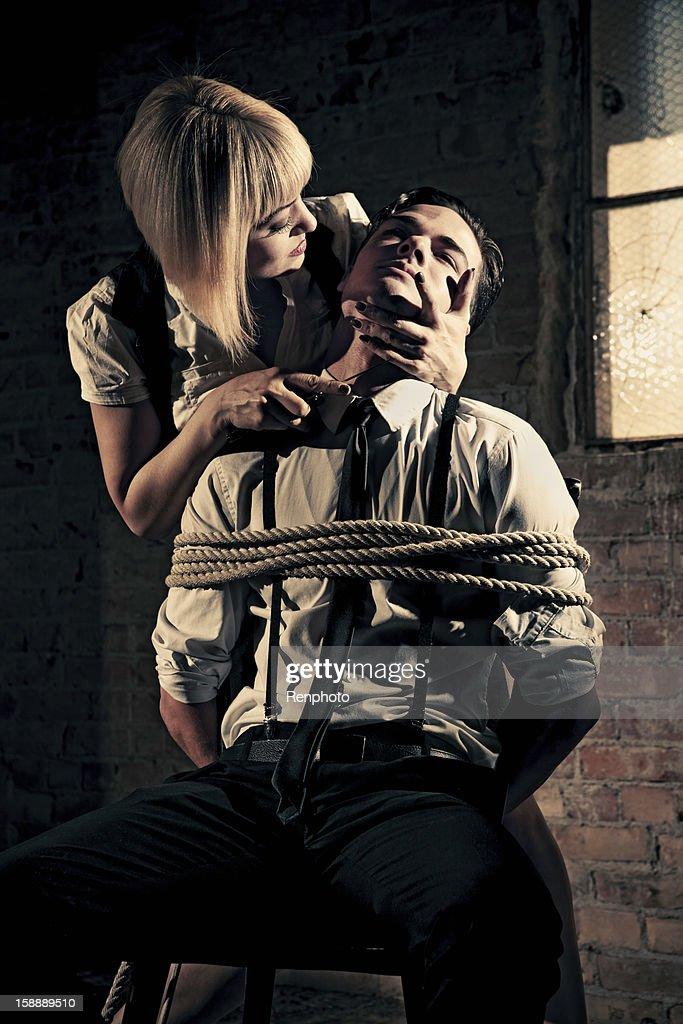 Threatening a Hostage : Stock Photo