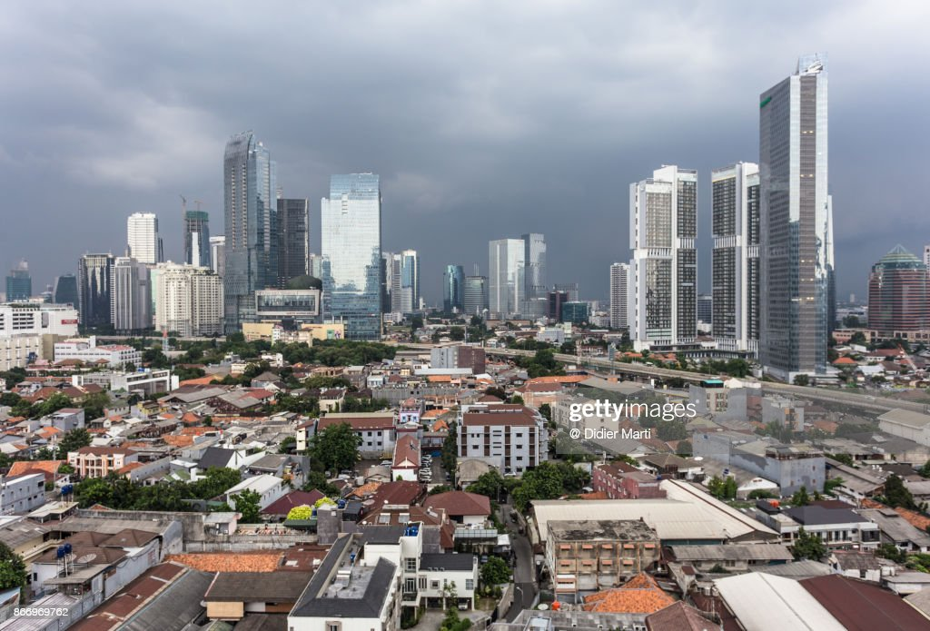 Threatening clouds over Jakarta skyline, Indonesia capital city : Stock Photo