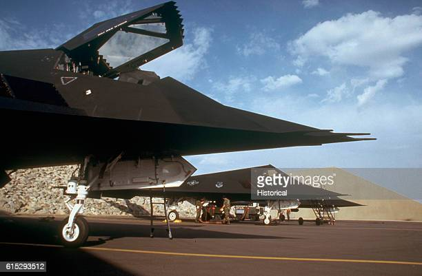 Three 37th Tactical Fighter Wing F117A aircraft are serviced by ground crews during Operation Desert Storm Saudi Arabia 1990