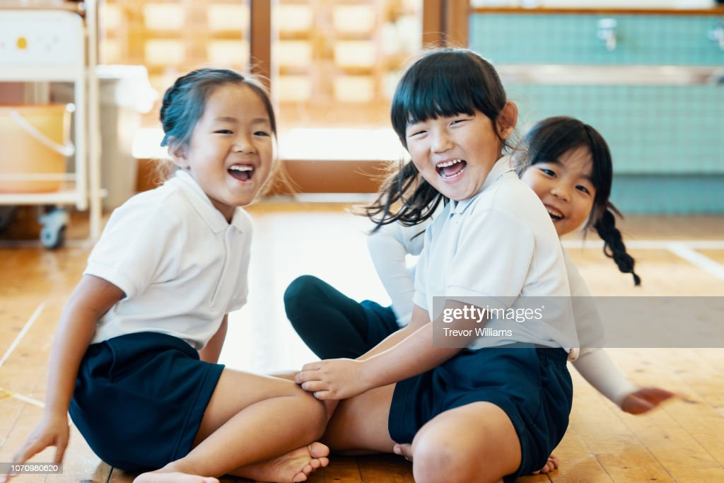 Three 5 year old girls sitting together at preschool : Stock Photo