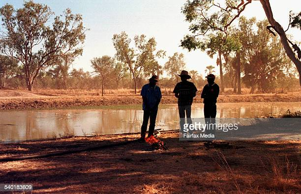 Three aboriginal men standing by a river making a fire 23 August 2001 AFR Picture by ROBERT ROUGH