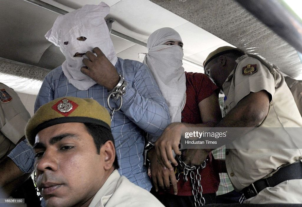 Three accused Purushottam Rana (blue shirt), Amit (green shirt) and Sunil Mann (red shirt) in BSP leader Deepak Bhardwaj murder case being produced by Delhi Police at Patiala House Court on April 2, 2013 in New Delhi, India. Bharadwaj, the richest candidate in the 2009 Lok Sabha polls from Delhi with declared assets of over Rs 600 crore, was shot dead on March 26 at around 9 am by unidentified men in his 35-acre farmhouse in south Delhi's Rajokri.