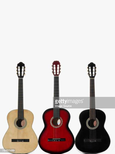 three acoustic guitars - acoustic guitar stock pictures, royalty-free photos & images
