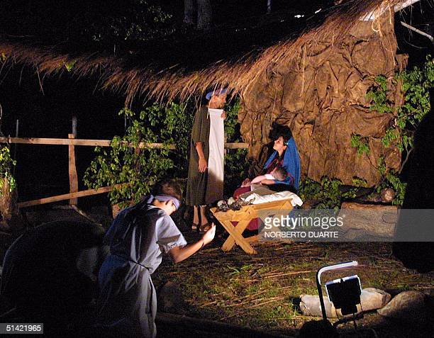 Three actors and a baby represent the birth of the Jesus in a living crib in Lambare located 10 km of Asuncion Paraguay 16 December 2000 for the...