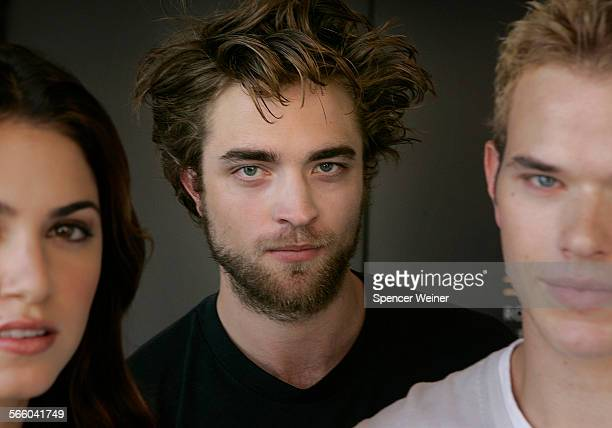 Three actors who will appear in the upcoming Twilight movie Robert Pattinson center Nikki Reedleft and Kellan Lutz right Film is the big screen...