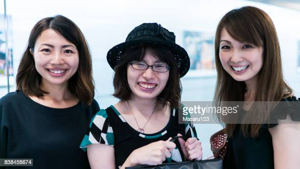 three adult women standing san smiling - alumni stock pictures, royalty-free photos & images