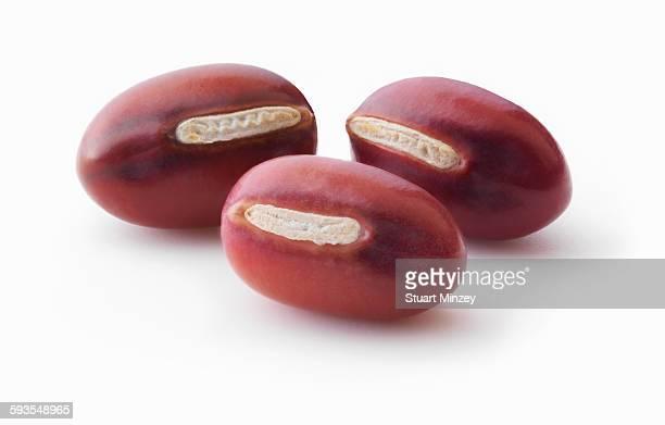 Three adzuki beans on white background