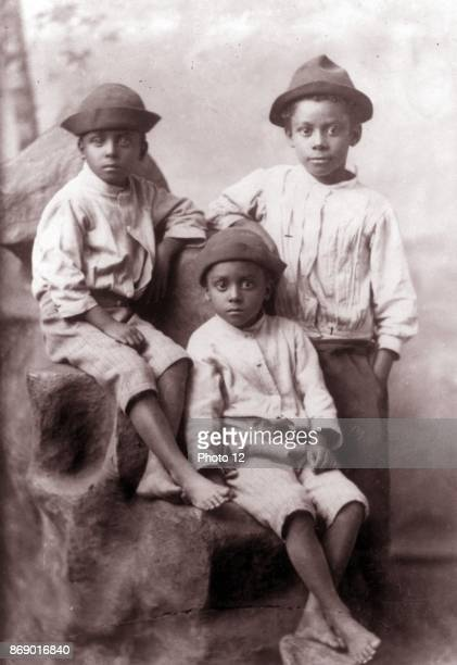 Three African American boys fulllength portrait facing front Types of American Negroes compiled and prepared by WEB Du Bois