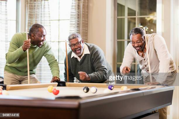 three african-american men playing billiards - old men playing pool stock pictures, royalty-free photos & images