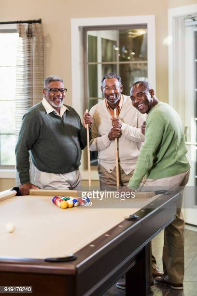 three african-american men shooting pool - old men playing pool stock pictures, royalty-free photos & images
