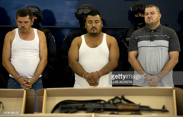 Three alleged drug traffickers members of the Sinaloa Cartel are presented to the press in Mexico City on July 12 after the Mexican Federal Police...