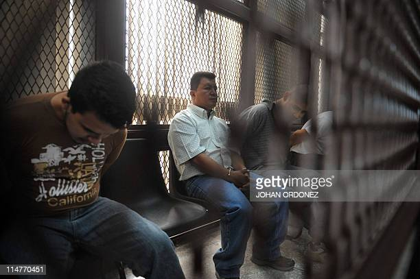 Three alleged members of the Mexican drug cartel Zetas remain in a security cell at court in Guatemala City on May 26 charged with the multiple...