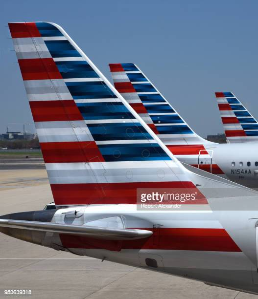 Three American Airlines Embraer passenger aircraft parked at their gates at Ronald Reagan Washington National Airport in Washington DC