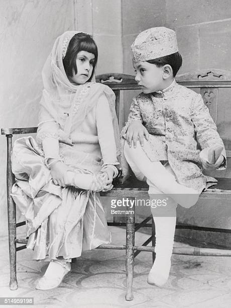 Three and half year old Shahrukh Khan and his six year old sister Zamzam Khan doff their shoes before entering the Shah Jehan Mosque in Woking The...