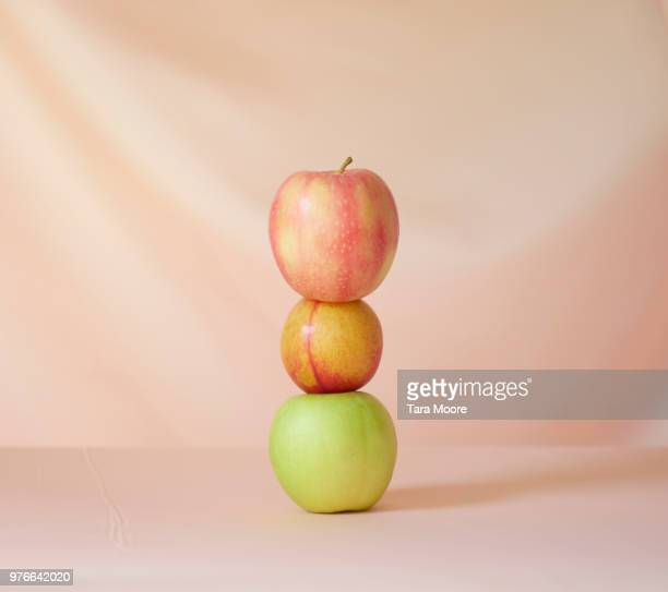 three apples in a pile - apple stock pictures, royalty-free photos & images