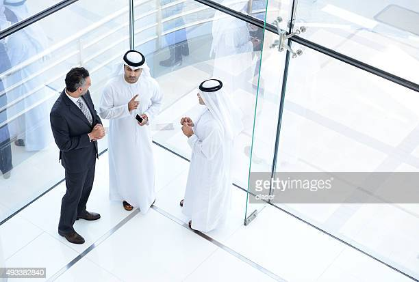 three arab business men meeting - united arab emirates stock pictures, royalty-free photos & images