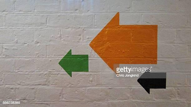 Three arrows on a wall