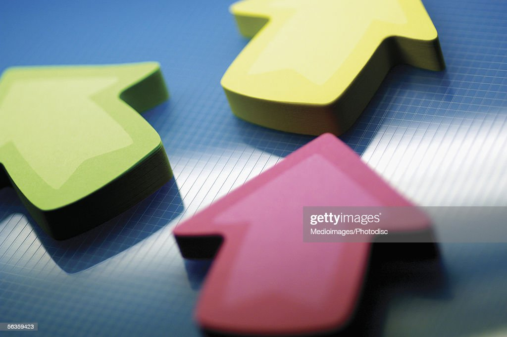 Three arrows pointing up, close-up : Stock Photo