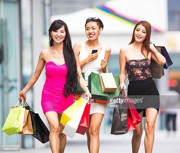 Three asian girls shopping
