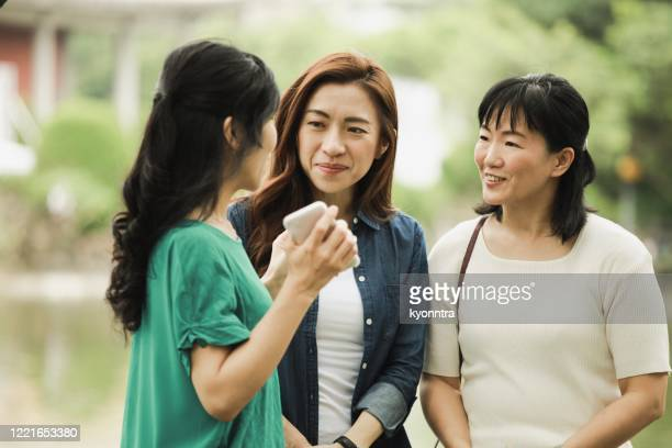 three asian women chatting - kyonntra stock pictures, royalty-free photos & images