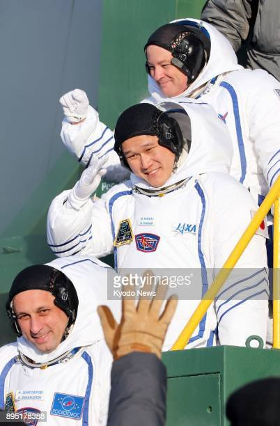 Three astronauts Scott Tingle of the United States Norishige Kanai of Japan and Anton Shkaplerov of Russia board a Russian Soyuz spacecraft at the...