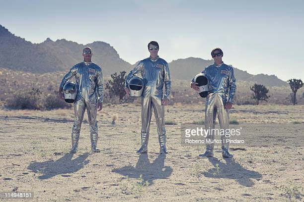three astronauts standing side by side - astronaut stock-fotos und bilder