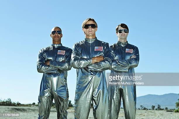 Three astronauts stands