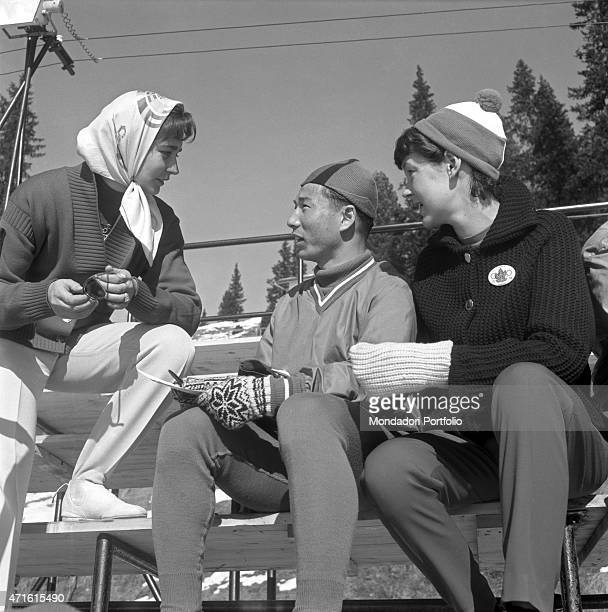 Three athletes competing in the VII Olympic Winter Games talking during a break Cortina d'Ampezzo 1956