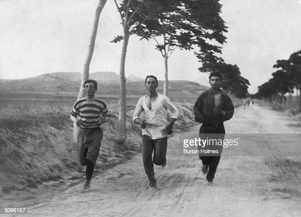 Three athletes in training for the marathon at the Olympic Games in Athens.