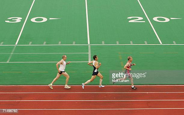 Three athletes running on the straightaway of a track and field event at the Gay Games VII at Hanson Stadium July 21 2006 in Chicago Illinois