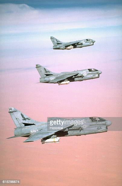 Three Attack Squadron 72 A7E Corsair aircraft en route to their targets during Operation Desert Storm The aircraft are carrying Mark 20 Rockeye II...