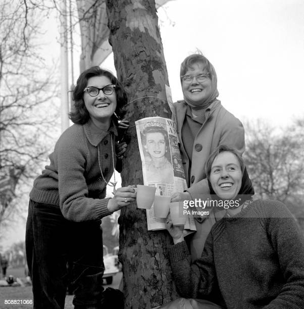Three Australian girls left to right Heather Cathcart Helen Chapple and Jean Gibb encamped in The Mall in readiness for the wedding of Princess...