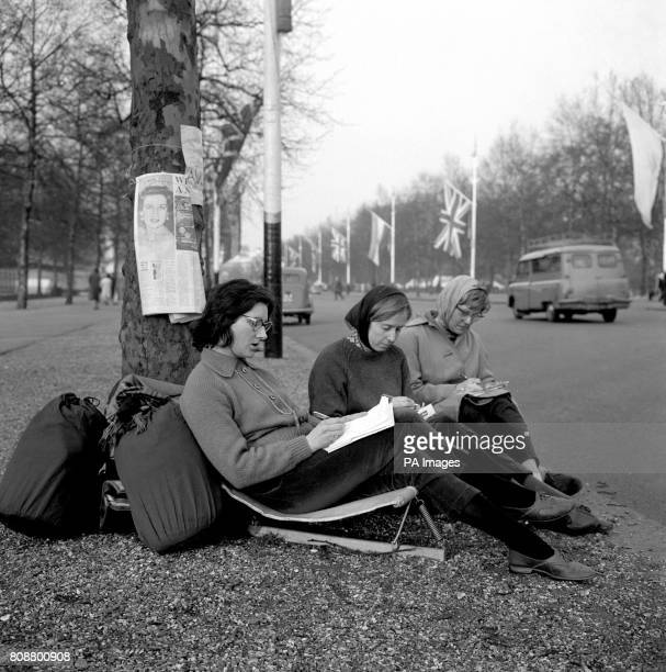 Three Australian girls left to right Heather Cathcart Jean Gibb and Helen Chapple encamped in The Mall in readiness for the wedding of Princess...