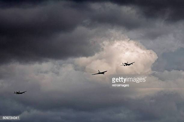 three avro aircraft flypast - lancasters and vulcan bombers - dambusters stock pictures, royalty-free photos & images