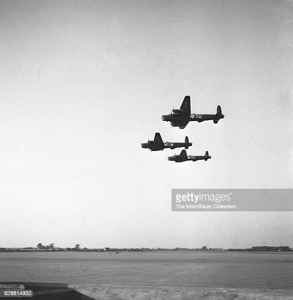 Three Avro Lincoln four-engined Second World War heavy bombers flying over British airbase designed and built by Avro for the Royal Air Force circa...