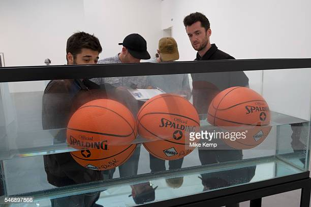 Three Ball 50/50 Tank basketballs at 'Jeff Koons Now' art show at Newport Street Gallery in London England United Kingdom Jeff Koons is a modern...