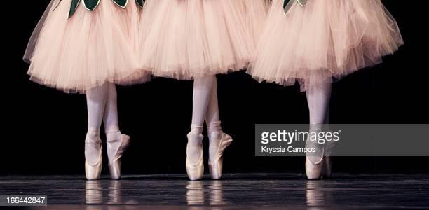 Three ballerinas on pointe