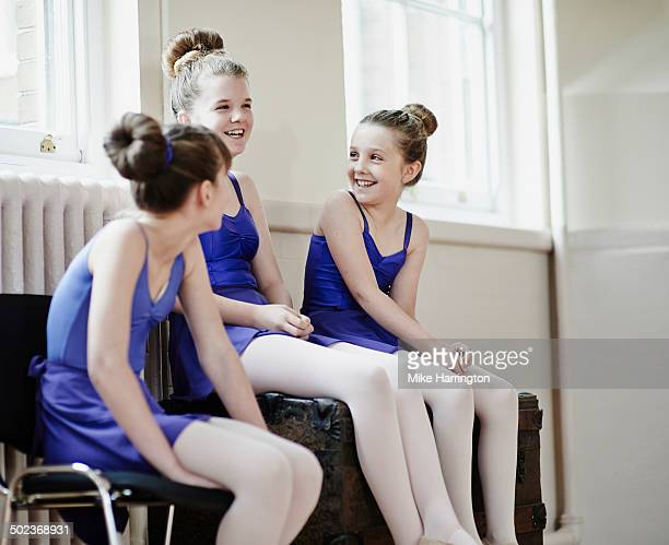 three ballet dancers laughing together - teen girls in tights stock photos and pictures
