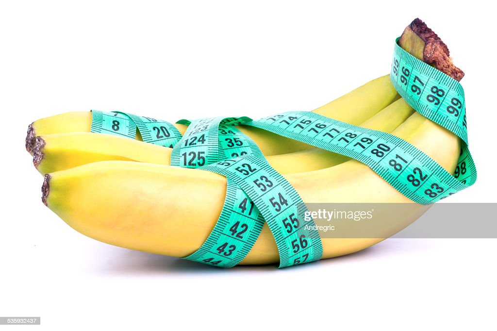Three bananas and meter : Stock Photo