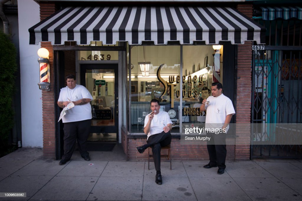 Three barbers hanging out : Stock Photo
