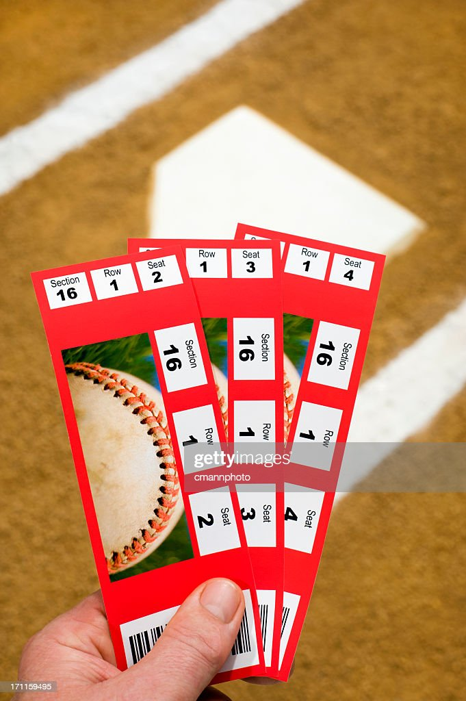 Three Baseball Tickets with home plate in background : Stock Photo