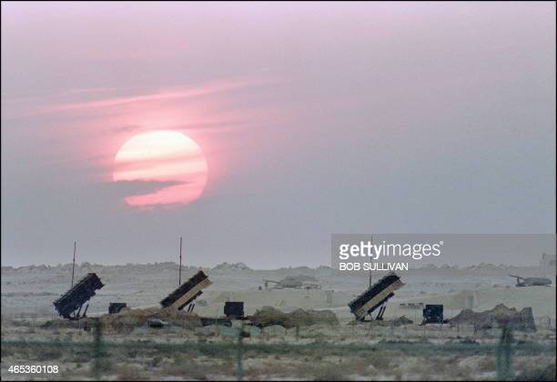 Three batteries of the USmade Patriot antimissile missiles are lit up by the sunset 25 January 1991 in Saudi Arabian desert during the Gulf War...