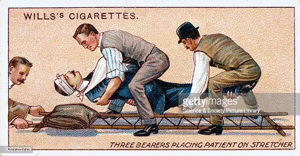 Three bearers placing a patient on stretcher' Wills' cigarette card 1913 One of a series of 50 'First Aid' cigarette cards issued by WD HO Wills The...