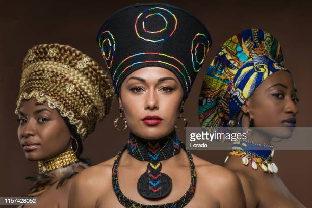 three beautiful black women wearing african headdresses - african tribal culture stock pictures, royalty-free photos & images