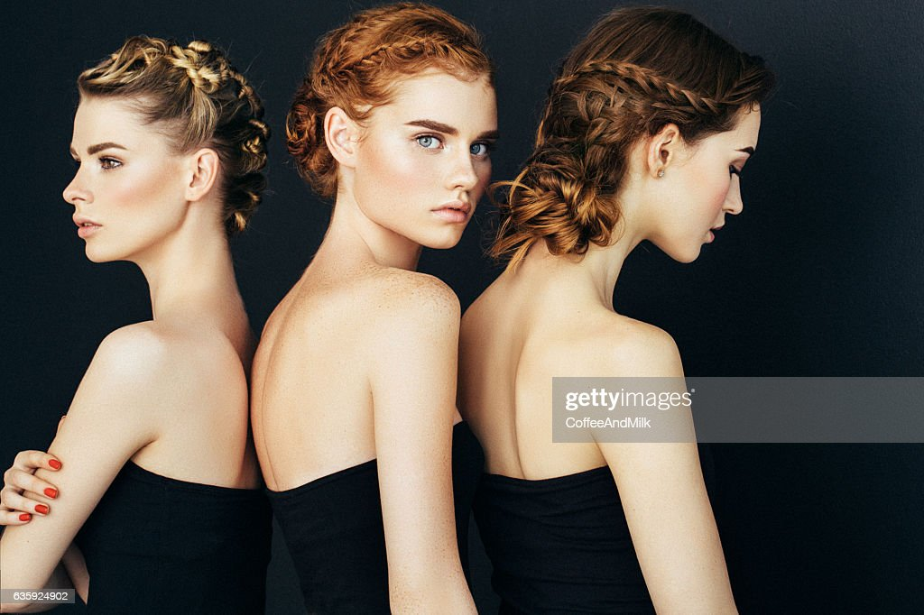 Three beautiful girls with a natural make-up : Stock Photo