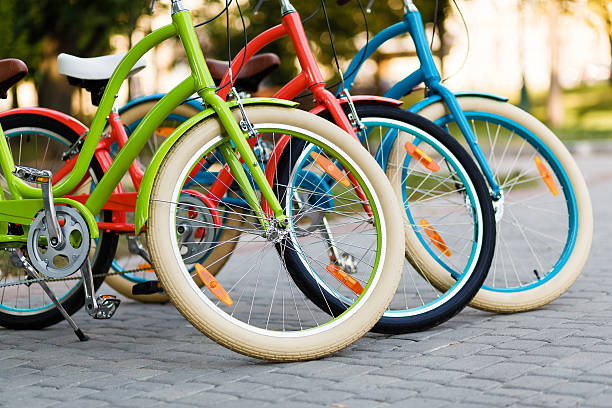 Three beautiful lady city bikes.
