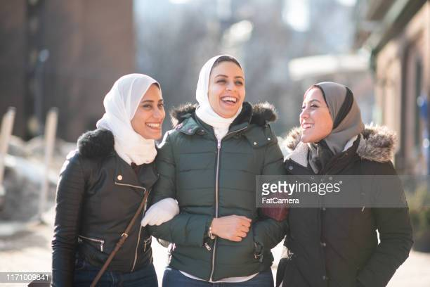 three beautiful muslim sisters - sister stock pictures, royalty-free photos & images