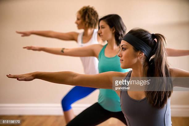 Three Beautiful Women Doing Yoga Indoors