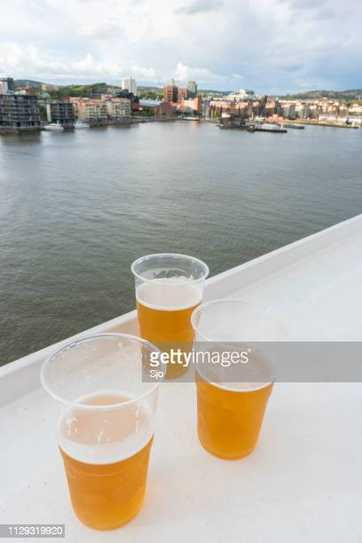 three beers and view on västra eriksberg in the port of gothenburg in sweden on a stormy day. - dalsland stock photos and pictures