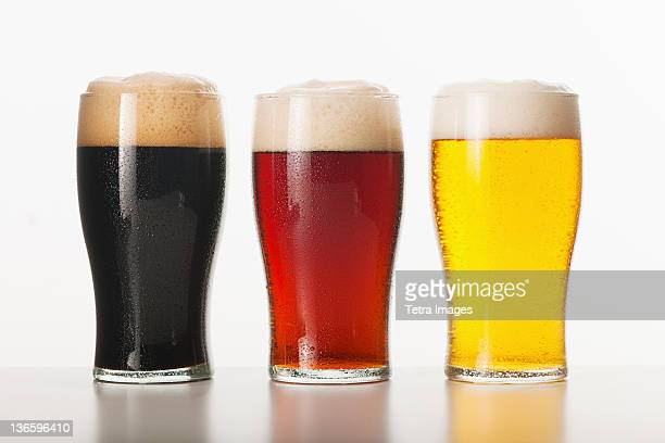 three beers in glasses, studio shot - beer glass stock pictures, royalty-free photos & images
